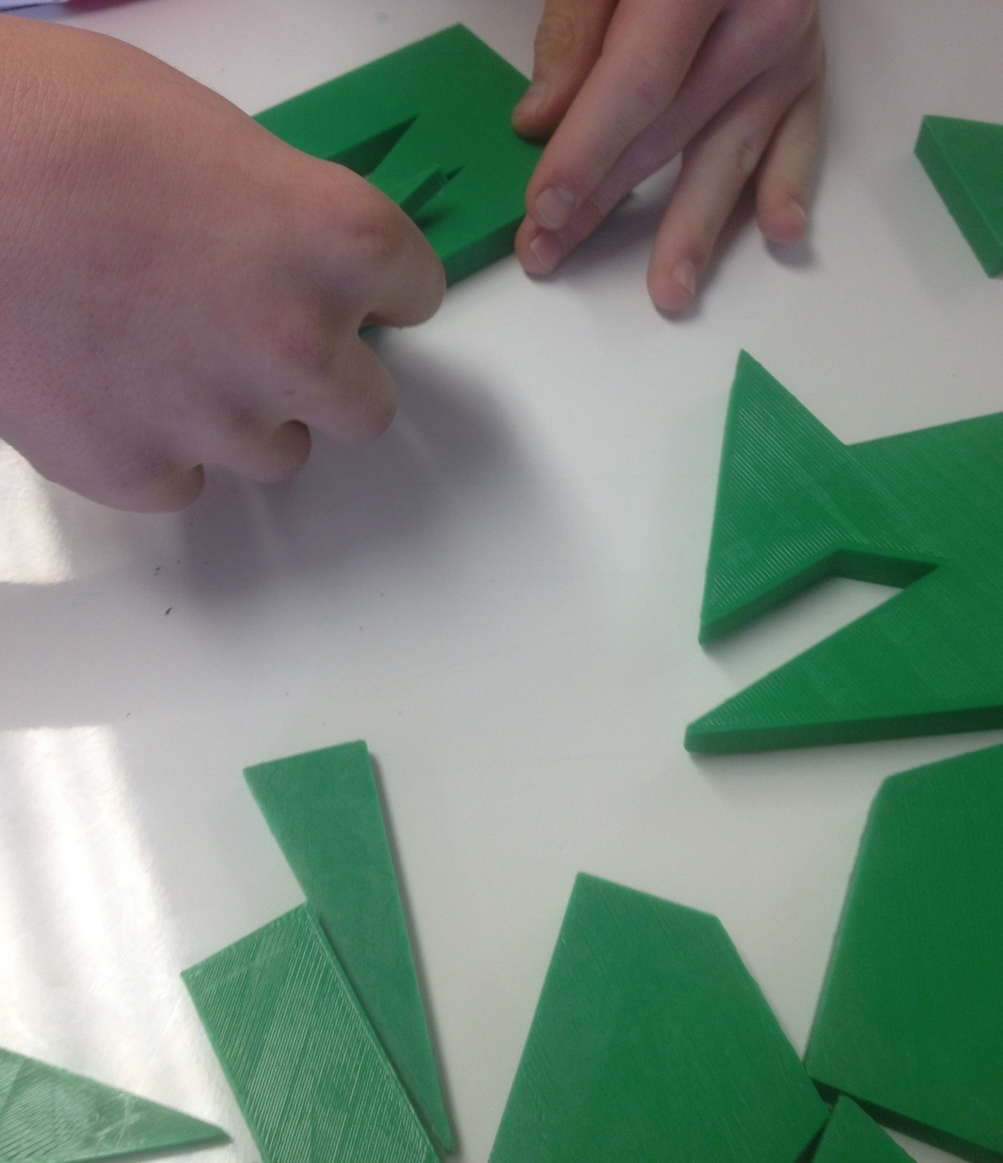 Hands of student using 3d objects
